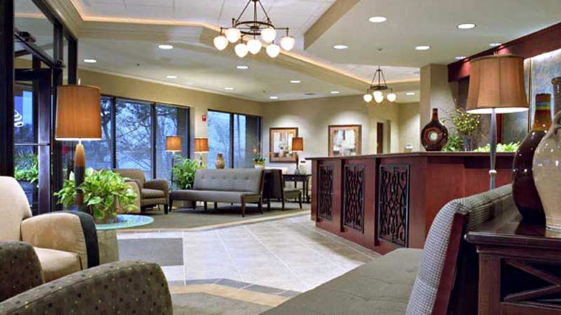 Interior of Office lobby with front desk, couches and seating areas