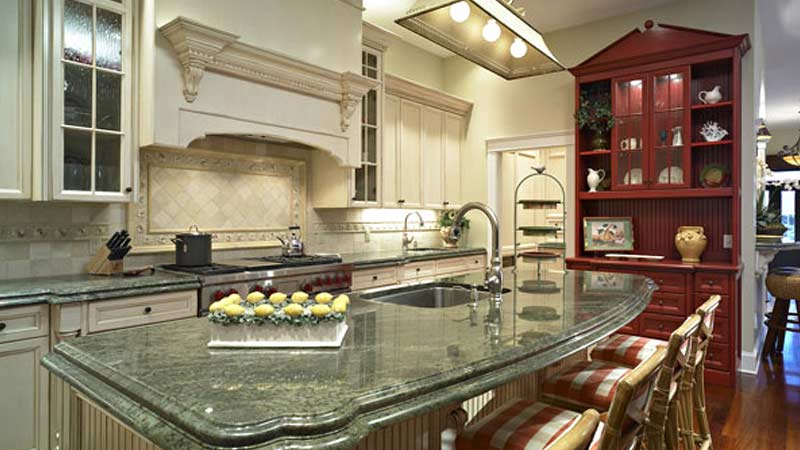 Residential kitchen with custom cabinetry and marble countertops