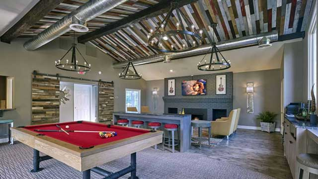Clubhouse with pool table, seating area and large screen TV