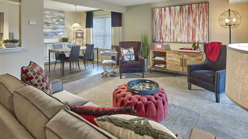 Multifamily furnished apartment living and dining room area