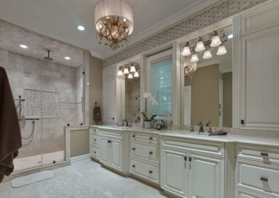 Voorhees Residence bathroom with dual sinks and walk-in shower