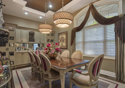 Voorhees Residence dining room with large lighting fixture above the table
